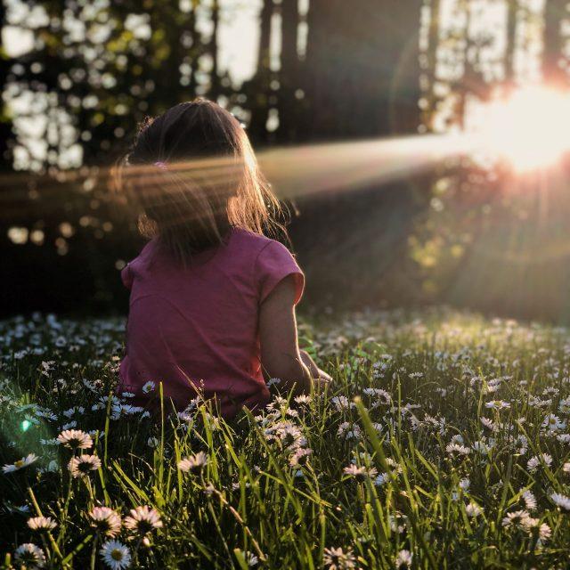 Girl sitting in sunlight